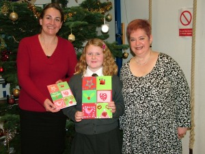Natascha, Alice and Headteacher Mrs Girdler holding the winning design